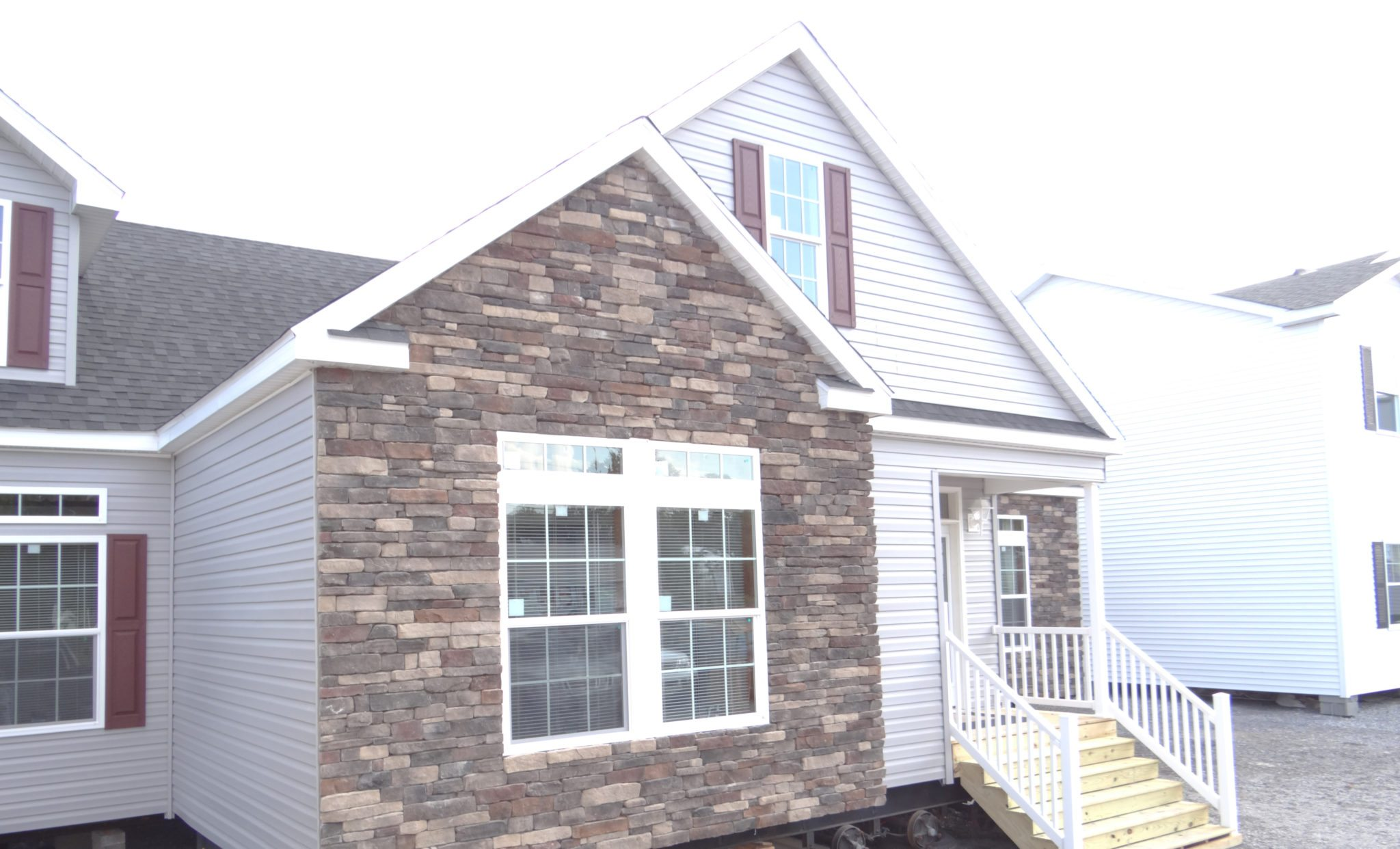 A stone or brick exterior on manufactured or modular homes Exterior stone veneer installation cost